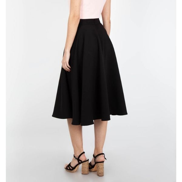 Front view of black circle swing skirt hem fall below the knee with pockets