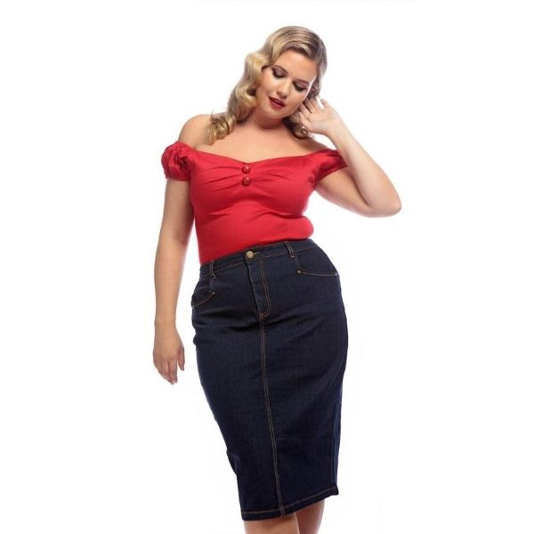 Model wearing Below Knee length Denim pencil skirt with contrast orange stitching button and zip front fastening