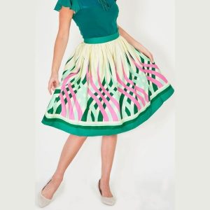 front view of mid length 50's styledswing skirt with swirls of pink and green with a bold green hem border