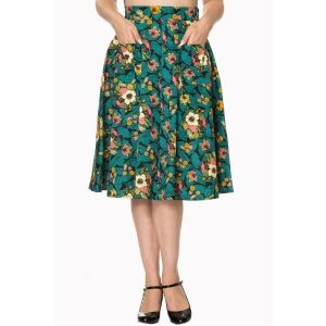 front view tropical print skirt with teal leaves cream yellow pink flowers and pineapples melon and oranges