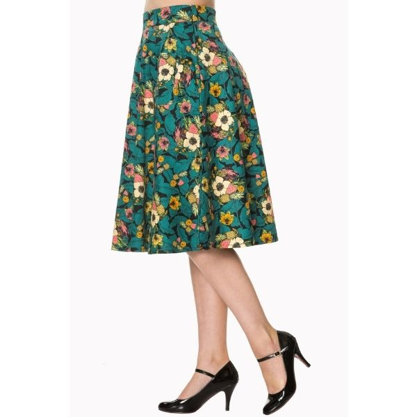 side view tropical print skirt with pockets teal leaves cream yellow pink flowers and pineapples melon and orange