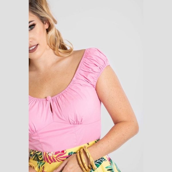 close up view pale pink top elasticated rouche cap sleeve sweetheart neckline with keyhole and bitton detail in the middle