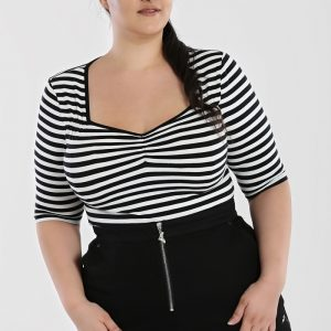 front view 50's style white and black horizontal stripe top sweetheart neckline with black edging. 3/4 length sleeves gather at the bust. hem ends on the hips